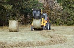 Machine with straw bales Royalty Free Stock Images