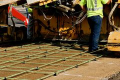 Machine to lay concrete to create a new sidewalk Royalty Free Stock Images