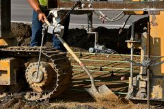 Machine to lay concrete to create a new sidewalk Stock Photography