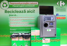 Machine to recycle plastic bottles and cans. First machine to recycle plastic bottles and cans and provides money for it in supermaket Carrefour Baneasa,Romania Stock Photo