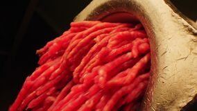 Machine tool makes fresh minced meat on black background