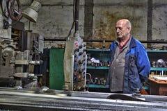 Machine tool operator, planer boring milling controls  processin Royalty Free Stock Photo