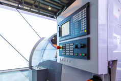 Machine tools with Computer Numerical Control CNC . CNC is the automation of machine tools that are operated by. Precisely programmed commands encoded on a stock photography
