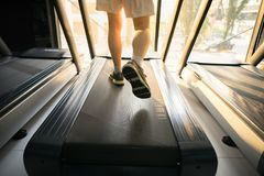 Machine treadmill with people running closeup at fitness gym Royalty Free Stock Photos