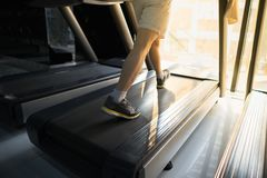 Machine treadmill with people running closeup at fitness gym Royalty Free Stock Photography