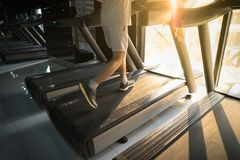Machine treadmill with people running closeup at fitness gym Royalty Free Stock Images