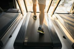 Machine treadmill with people running closeup at fitness gym Royalty Free Stock Photo
