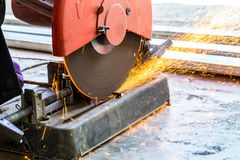Machine used for cutting steel. Workers are working using steel cutters to make sparks fly. Is a work in industry stock image