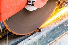 Machine used for cutting steel. Workers are working using steel cutters to make sparks fly. Is a work in industry stock photo