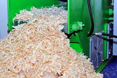 Machine for utilization of wood in sawdust.  Stock Images