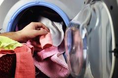 Machine Washer hand put Stock Images