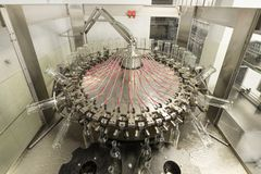 The machine for washing glass bottles. Factory for bottling alcoholic beverages Royalty Free Stock Image