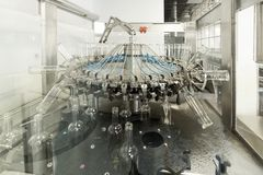 The machine for washing glass bottles. Factory for bottling alcoholic beverages Stock Image