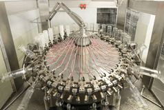The machine for washing glass bottles. Factory for bottling alcoholic beverages Stock Photos