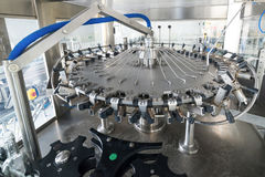 The machine for washing glass bottles. Factory for bottling alcoholic beverages Stock Photo