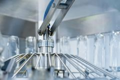 The machine for washing glass bottles. Factory for bottling alcoholic beverages. Close-up photo Stock Photos