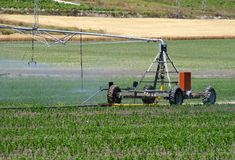 Machine watering the field Royalty Free Stock Photography