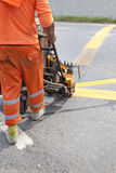 Machine and worker at road construction use for road and traffic sign painting. And road construction Royalty Free Stock Photography
