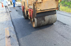 Machine working of asphalt road construction Stock Photos