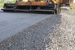 Machine working of asphalt road construction Royalty Free Stock Image
