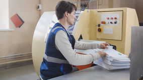 Machine working in printing house, polygraph industry Stock Photos