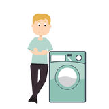 Machinealaver. Man with a washing machine, home appliances Stock Photography
