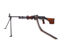 Machinegun with ammo chain Royalty Free Stock Photos