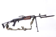 Machinegun with Bayonet. Old machinegun with tripod and bayonet isolated on white background Stock Image