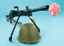 Machinegun And Flowers Stock Photos