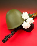 Machinegun And Flowers Royalty Free Stock Photography