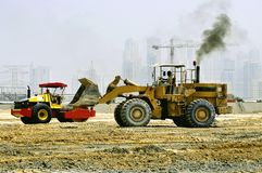 Machineries. Constructions machineries in the middle of the desert Stock Photography