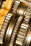 Machinery. Shiny new cogwheels of an industrial machine Royalty Free Stock Image