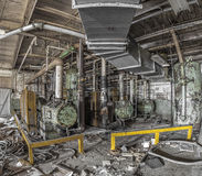 Machinery in an abandoned factory royalty free stock image