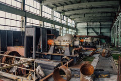 Machinery of abandoned factory of synthetic rubber. Interior of machinery of abandoned factory of synthetic rubber Stock Photos