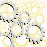 Machinery in action. A silver and gold background with wheels of different sizes Stock Images
