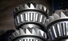 Roller bearings on gears. Machinery concept. Set of various gears and ball bearings old and new stock images