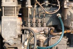 Machinery concept. Tractor machine engine closeup with selective focus. stock image