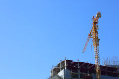 Machinery crane in construction site building Royalty Free Stock Photo