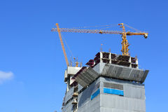Machinery crane in construction site building industry. With clear blue sky background Stock Image