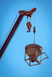 Machinery crane hoisting cement mortar mixer bucket Stock Images