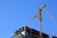 Machinery crane working in construction site building. Industry Stock Image