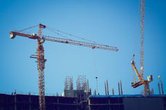 Machinery crane working in construction site building industry Royalty Free Stock Photo