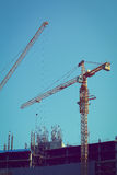 Machinery crane working in construction site building industry Royalty Free Stock Photography