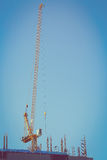 Machinery crane working in construction site building industry Royalty Free Stock Image