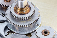 Machinery details. metal gearwheels on industrial background. Royalty Free Stock Photos