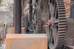 Machinery gears on the old factory Stock Photos