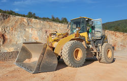 Machinery in the gravel pit Royalty Free Stock Photo