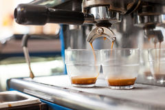 Machinery is making coffee for two cups Stock Images