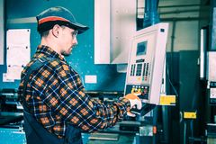 Machinery Operator at Work. Professional Machinery Operator at Work. Caucasian Factory Worker royalty free stock photos