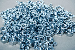 Machinery parts Nuts Stock Photos